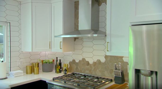 Anstead combined two very different tiles to create a funky backsplash in this kitchen renovation.