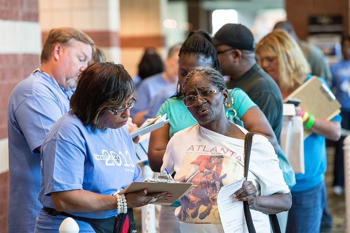 Volunteers check in patients to the free medical and dental care in North Charleston.