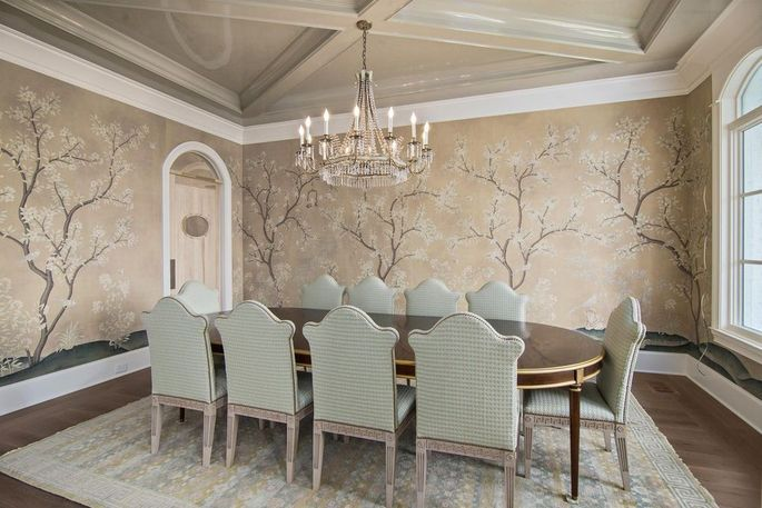 Formal dining room with custom-painted wallpaper