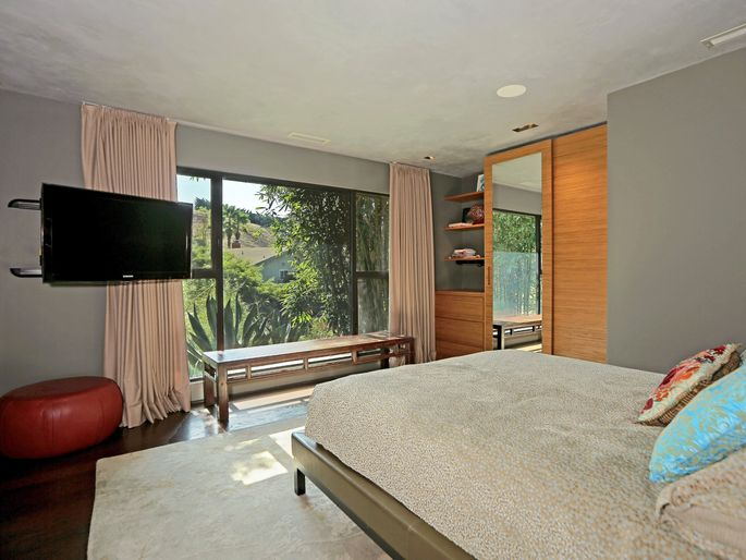 Floor-to-ceiling curtains make a room feel higher.
