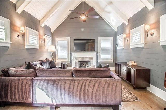 The Shiplap Walls Are A Trendy Touch.