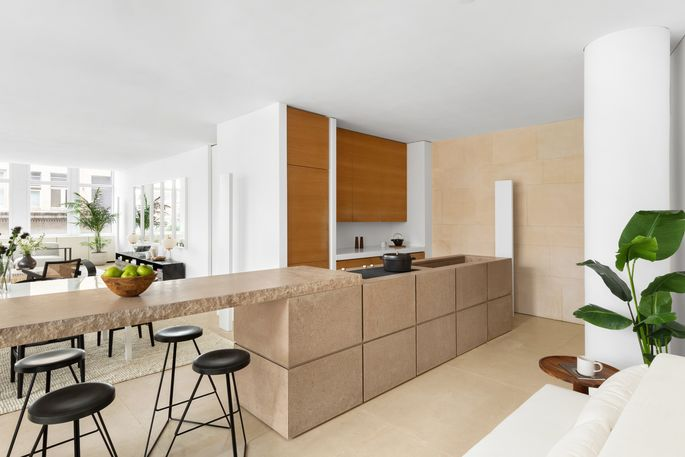The cook space features pear wood cabinets and Miele and Sub-Zero appliances.