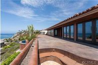 Lakers Exec Jim Buss Strikes a Deal in Dana Point