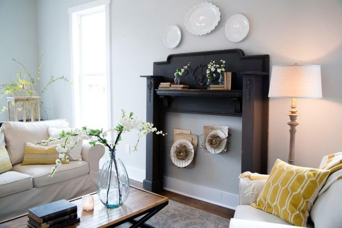 "Faux fireplace with ""interesting"" hangings in the middle"