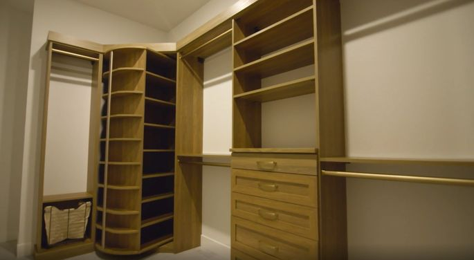 Victoria's closet design features a rotating shoe shelf.