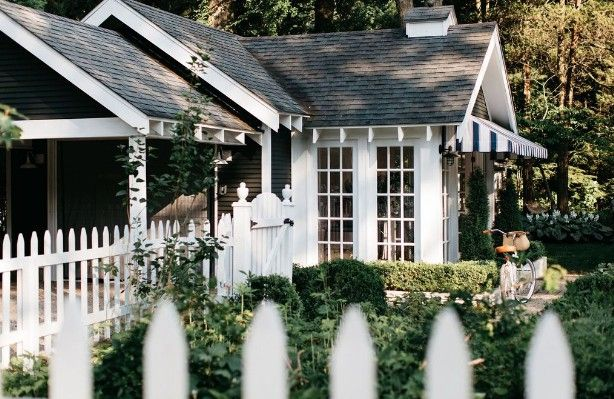 The cottage exterior is lush and welcoming.