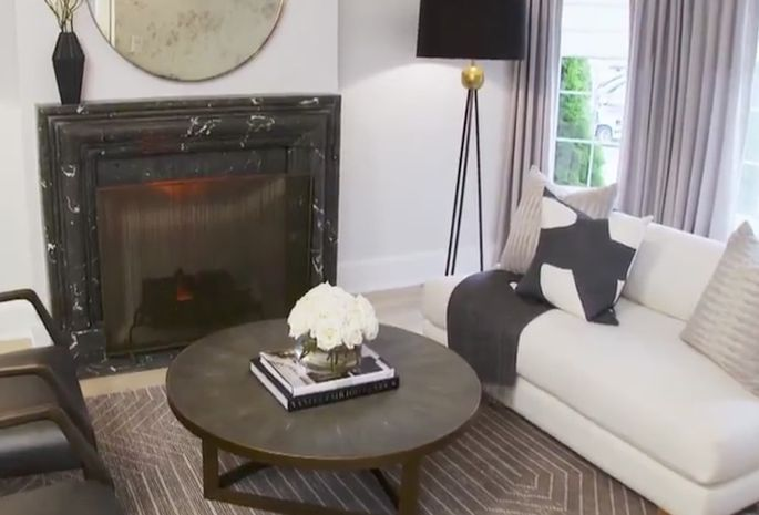 The faux-marble fireplace surround looks authentic.