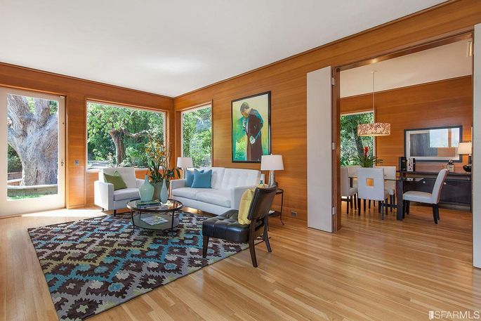 Wood-paneled living and dining rooms