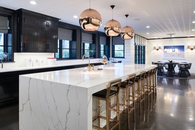 The modern kitchen features Carrara marble.