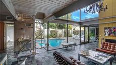 Dramatic Duplex Makeover in South Florida Makes for Midcentury Magic
