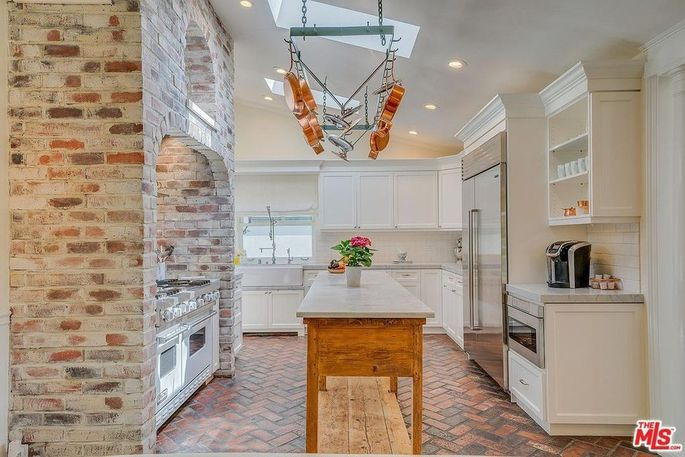 Kitchen with herringbone-patterned brick floor