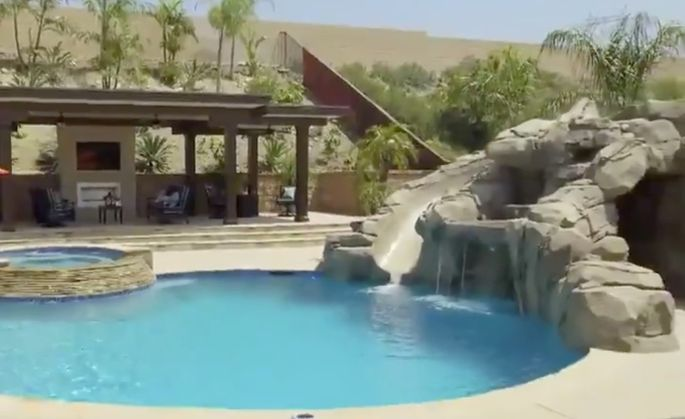 Pools these days feature fun elements like a grotto, cave, waterfall, waterslide, and elevated spa with a spillway.