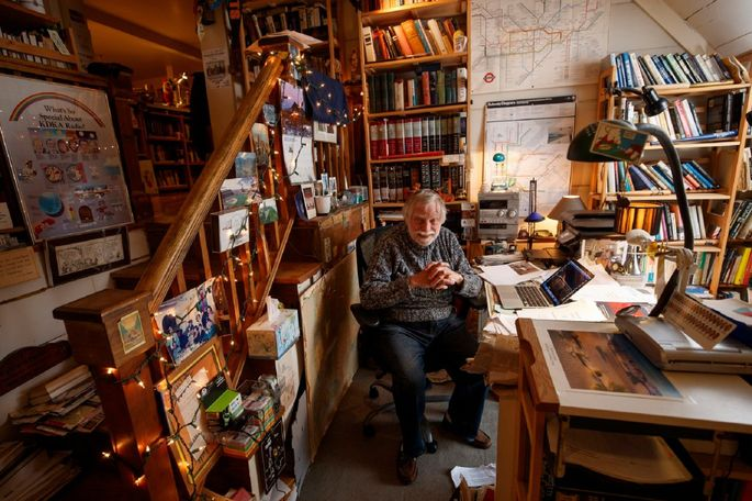 Roy Fox passes his days surrounded by his collection of 4,000 books in his apartment and office — the former servants' quarters — above the King Manor House in Jamaica, Queens.