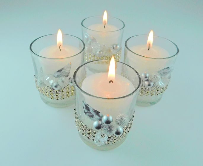 Grab your glue gun to beautify these glass candleholders.
