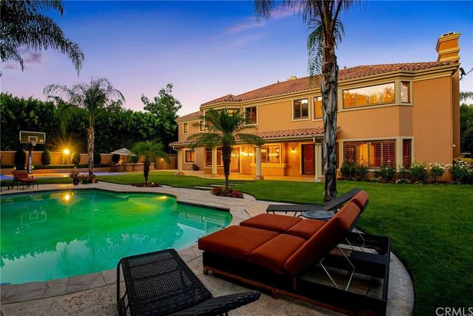 Grassy yard with pool