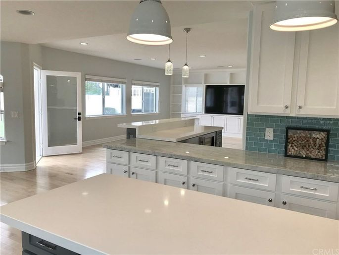 Kitchen and family room with bar