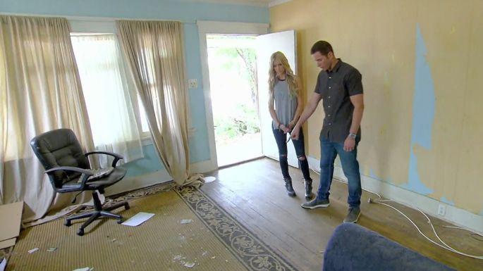Christina and Tarek El Moussa assess the interior.