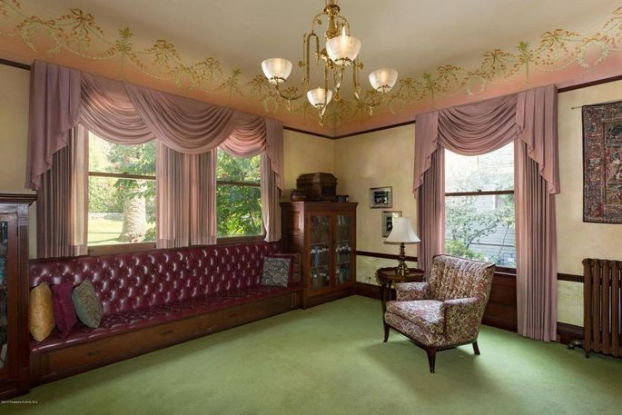 Parlor with restored leather upholstery and stenciling