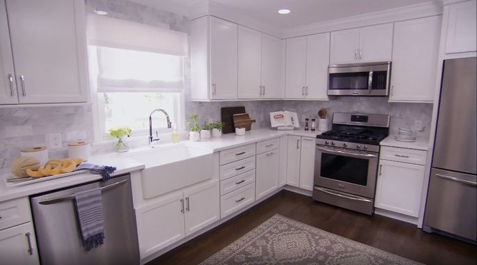 These white cabinets are clean, but the look is overdone.