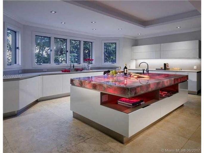 Chef's kitchen with custom-lit island