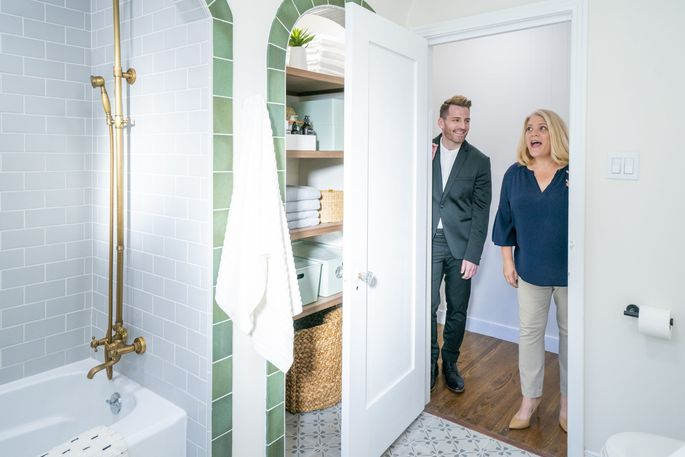 """The big """"reveal"""" on a renovated bathroom."""