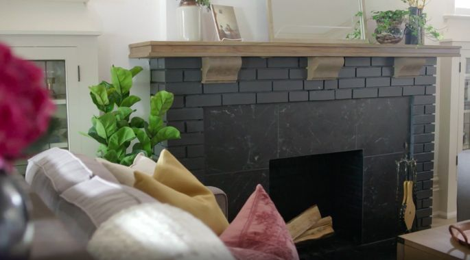 This dark fireplace is a gorgeous upgrade.