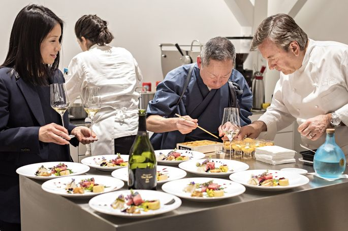 Ms. Goto with Chef Eiji Ichimura and Chef Daniel Boulud. The Michelin-starred chefs prepared a multicourse dinner in Ms. Goto's kitchen.