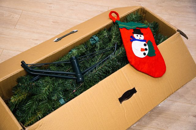 An open box with an artificial Christmas tree