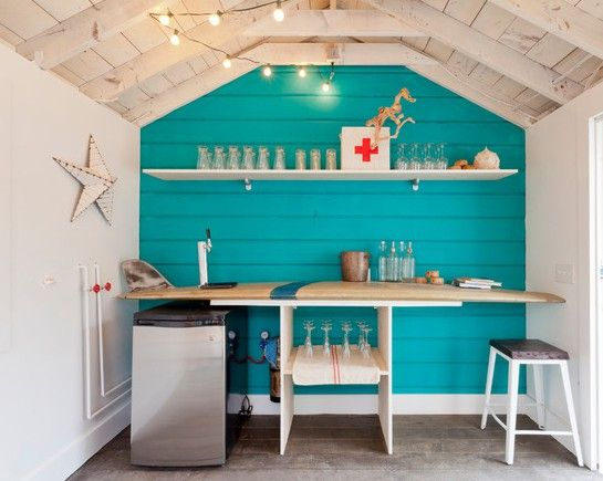 A surfboard bar adds a beach vibe to this bar shed.
