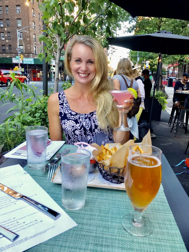 A Cosmopolitan at a sidewalk cafe in New York City in August