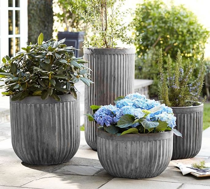 Planters are an easy way to add color to your yard.