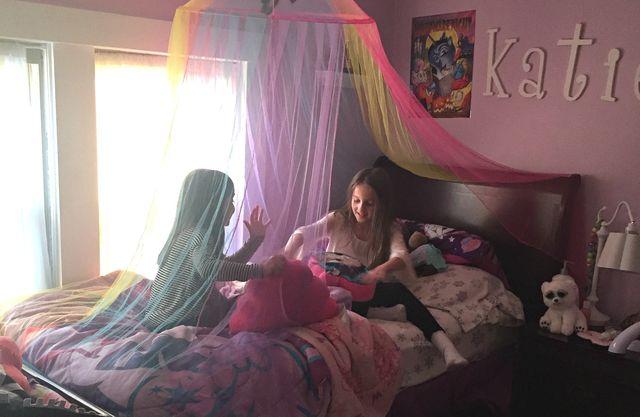 sisters in bedroom