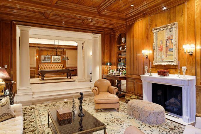 Wood-paneled billiard room and study