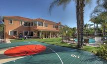 Which March Madness Coach Owns a Championship Home?
