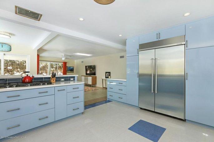 Freestanding cabinets surrounding the Sub-Zero refrigerator
