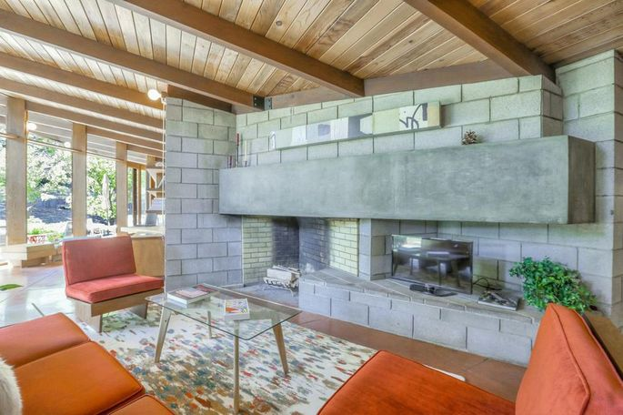 Living room with concrete-block fireplace