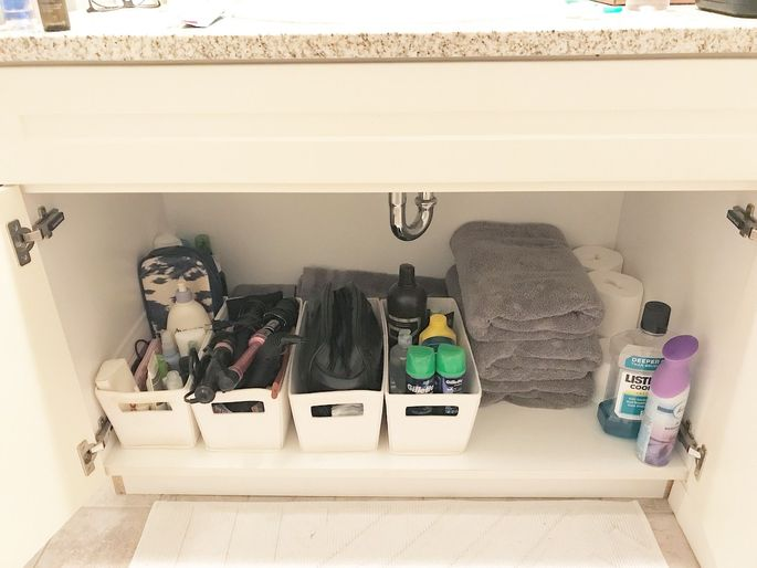 Use bins and baskets to keep under-sink clutter under control.