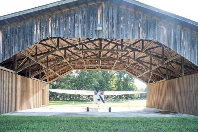 Ms. Bates' estate includes two grass airstrips and hangars because her husband was a racing pilot.
