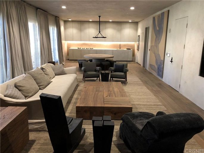 The open-concept space is sleek, stark, and modern.
