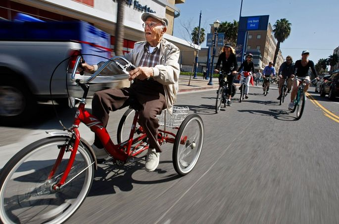 Octavio Orduno, 103, leads a pack of local cyclists through the streets of Long Beach, CA.