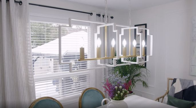 This chandelier brightens the space with a modern look.