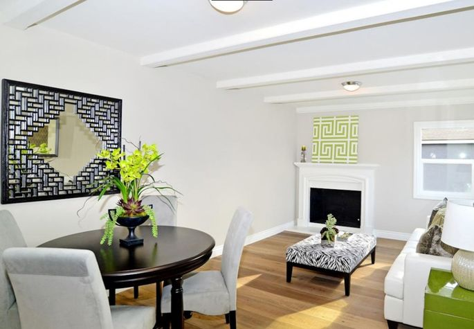 Christina and Tarek use light, bright colors on all surfaces, then add pops of green to make a home seemmore spacious and fresh.