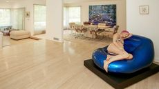 Can a Pregnant Lady in a Bikini Help Sell This Home?