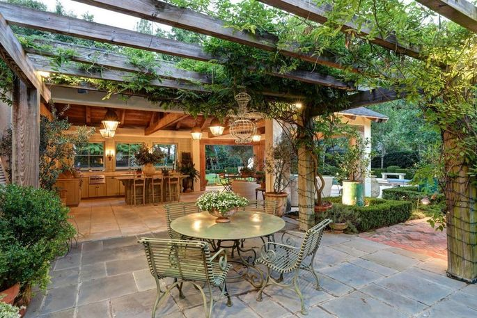 A French Provençal-style garden lends itself well to owners who love to cook and entertain.