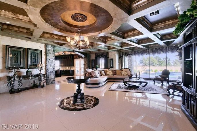 Living room with ornate ceiling