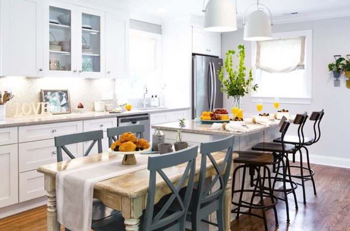 A kitchen island with an adjacent table works to double dining space.