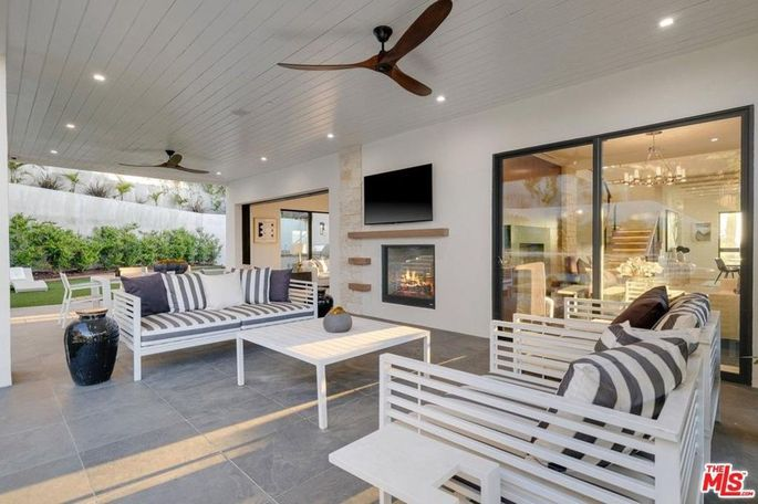 Indoor/outdoor California room with fireplace