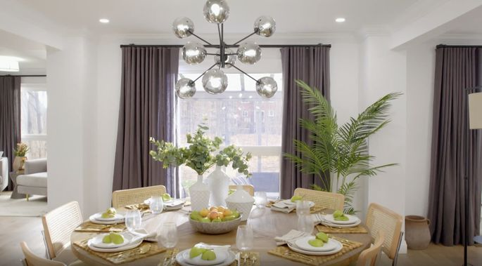 This modern light fixture is perfect for this dining space.