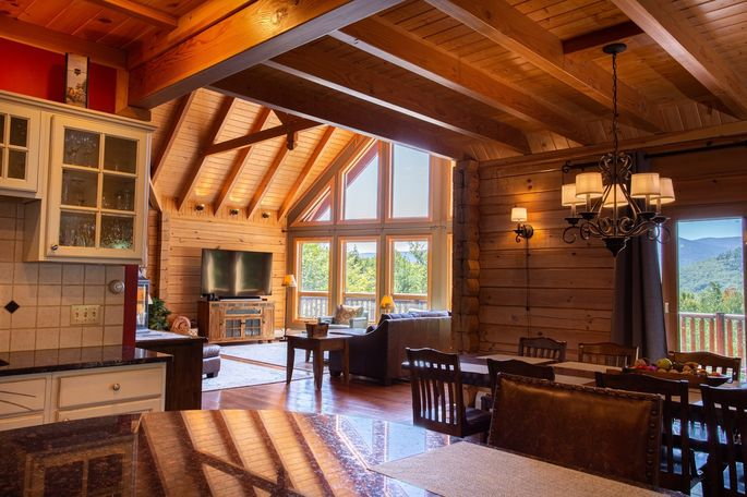The four-bedroom Black Bear Lodge has cathedral ceilings, floor-to-ceiling windows and views of nearby Mount Attitash.
