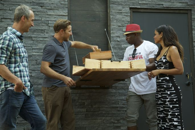 Zack Giffin shows Deion Sanders the fold-down table where he can clean the fish he catches.